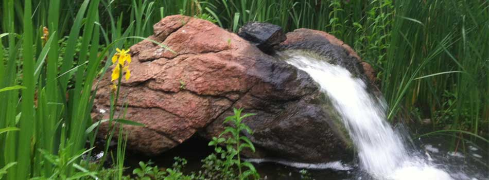 A pond less waterfall being installed at a home in Loveland, CO.