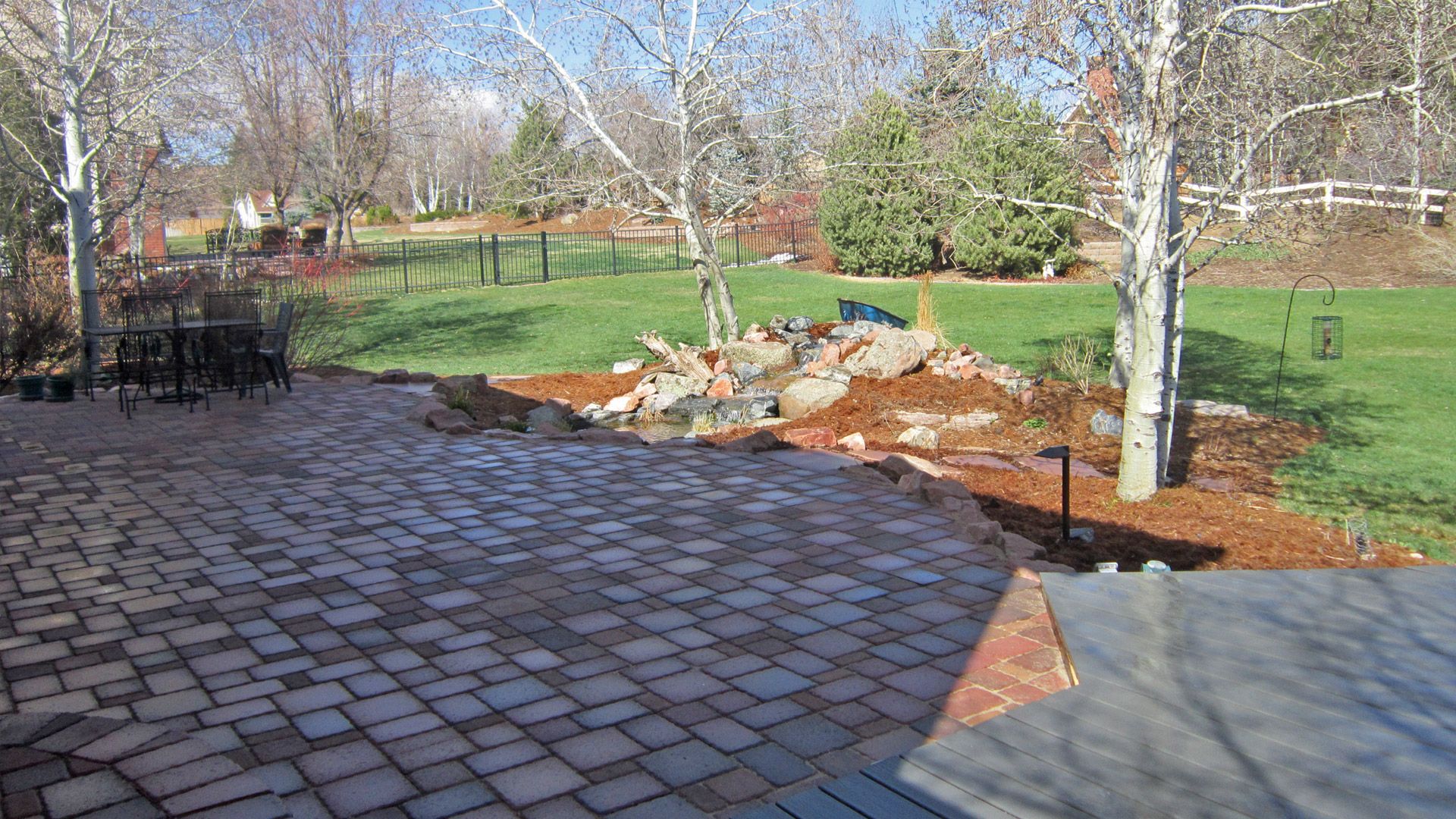 Example of a natural stone patio built by the professionals at Alive Outside Landscaping.