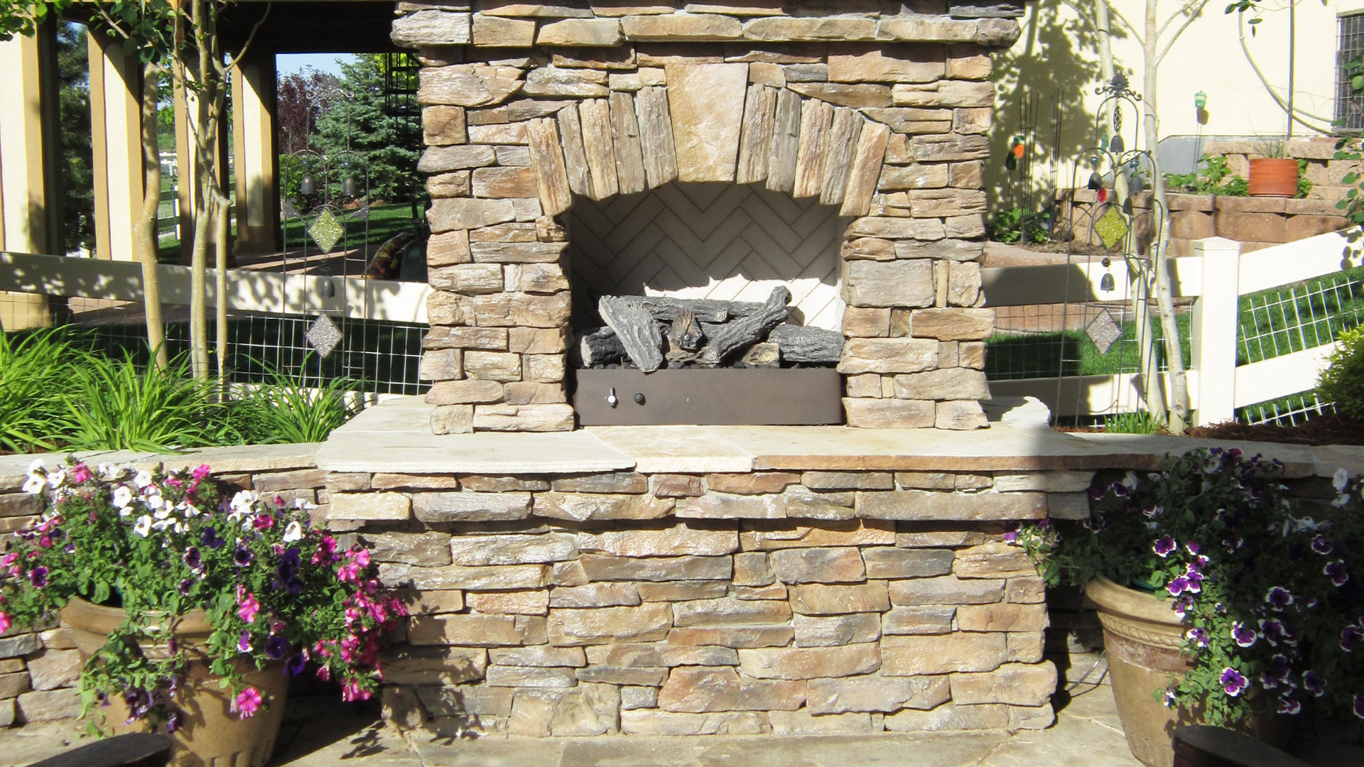 A brand new custom fireplace that was just installed in this homeowner's backyard in Loveland, CO.
