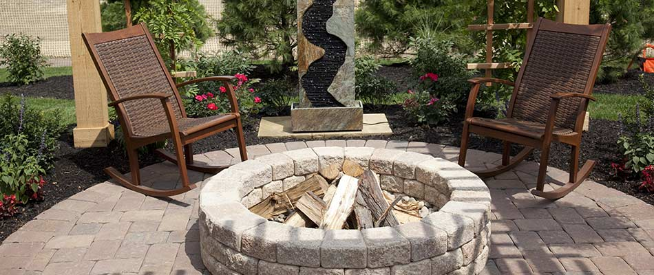 Concrete paver fire pit and patio design in Fort Collins, CO.