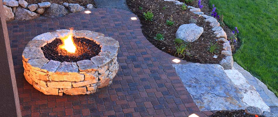 Stacked stone fire pit construction in Loveland, CO.