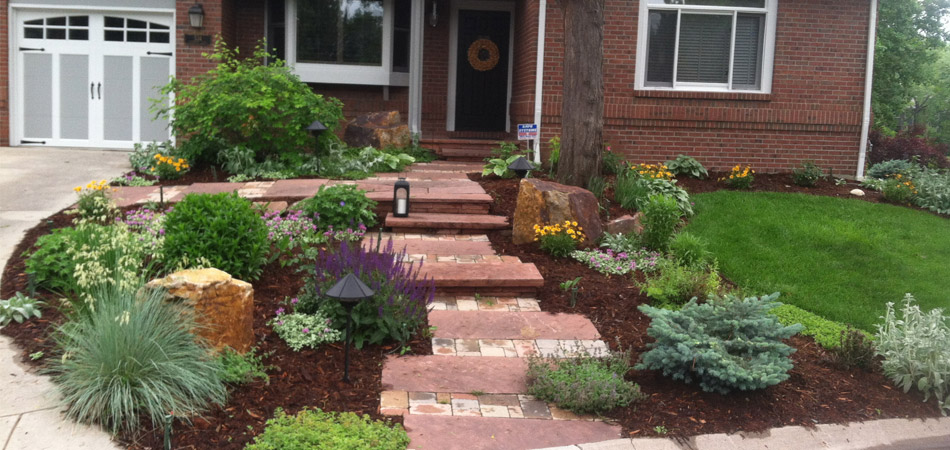 New landscaping installation with hardscaping in front of a home in Windsor, CO.