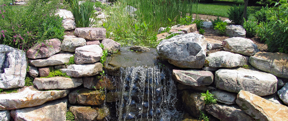 Why Your Outdoor Living Space Needs Custom Water Features
