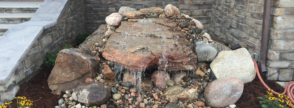 This homeowner opted to have a custom rock water fountain installed in front of their Loveland home.l