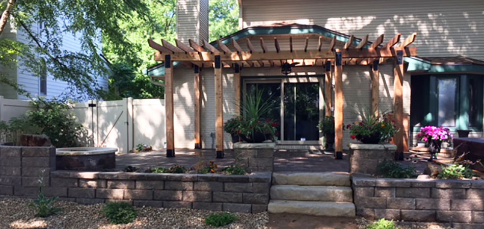 New Retaining Wall, Custom Patio, Fire Pit, & Landscaping in Fort Collins, CO