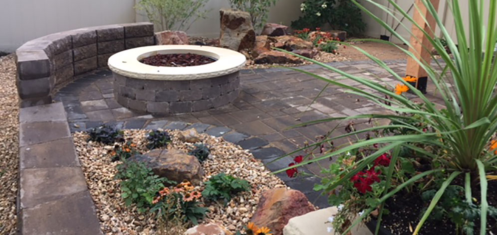 The finishing touches of this beautiful and functional hardscape project in Fort Collins was a landscape bed and river rock.